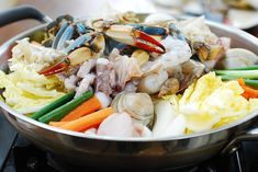 Haemul Jeongol (Spicy Seafood Hot Pot) || neck clams and/or mussels, blue crabs, squid and/or octopus, white flesh fish (snapper, tilapia, or monkfish), shrimp, soybean sprouts, napa cabbage,  Korean radish, carrot, onion, mushroom, scallions, watercress or crown daisy, soy sauce or fish sauce, garlic, ginger