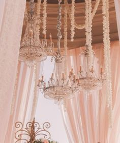 Wedding Ceremony- beautiful chandeliers, hanging flower strands, blush drapes, fantasy wedding www.aboutdetailsdetails.com