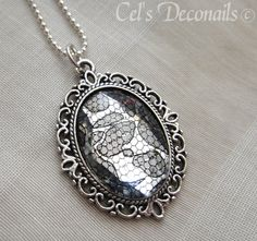 Black and Silver Pendant Necklace with Ornate Frame and Lace