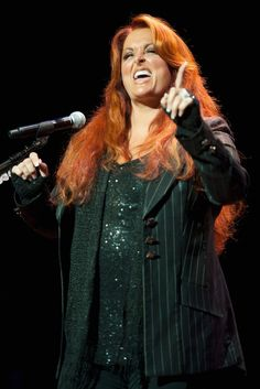 """Wynonna Judd (born May 30, 1964 in Ashland, Kentucky) is an American country music singer. Born Christina Claire Ciminella, she was renamed Wynonna Ellen Judd Roach, a name adapted from the line """"Don't forget Winona"""" in the pop song """"Route 66"""". Her solo albums and singles are all credited to the singular name Wynonna (IPA: /waɪˈnoʊnə/)."""