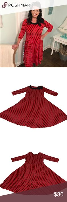 Rockabilly Polka Dot Retro A Line Red Pinup Dress This red and black polka dot dress is an A Line style with full skirt bottom. It features a black collar with bow, 3/4 sleeves, and back zipper. A definite statement dress! Size is XXL, but I was a size 10-12 in the photo. Please check measurements in listing. A unique dress that is perfect for your 1950s retro Rockabilly pinup style. Only worn once for an event. Like new! Smoke-free, dog friendly home. oxiuli fashion Dresses