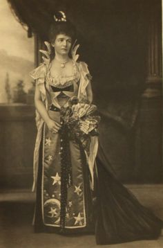 Lady Herschell looking slightly unhappy as Night (costumes expressing ideas like night and day were quite common at fancy dress parties).