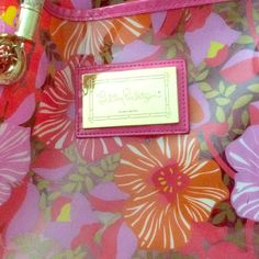 Lilly Pulitzer Multi Purpose Bag NWOT Very colorful multi functioning bag. Clear bag with the vibrant colors of orange pink lilac and a hint of yellow infused. Trimmed with patent leather pink and neutral tone braided handles. Gold hardware with an attached coin case, credit card case, makeup case, key case okay you get it ~ an attached little case! Great for the travel bag on the plane. Purse. Carry bag for work. Ok again you get it. Multi function bag!  The Plastic is still on the front LP…