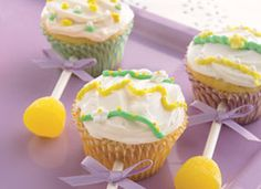 baby rattle cupcakes  .  great for showers. Use lollipop sticks and small gumdrops for the handle
