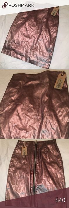 NWT All Saints Metallic Zip Skirt Sexy and fun it's a US size 0 but depending on how you wear it it can fit up to a 4-6 very sexy for any age dress it up or down!  It's a very chic bronze with a hint of rose gold making it spicy enough to wear with almost any color!  Wear it higher up to have a high waisted mini skirt look, wear it as a pencil skirt, pull it up even more and wear it as a dress... Like I said it's versatile! Original Price: $95.00 All Saints Skirts