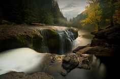 Looking southwest along the Lewis River at the top of the Lower Lewis River Falls as night falls and fog begins to form in the channel. This area is in the Gifford Pinchot National Forest in Washington State. Photo by: Scott Weber
