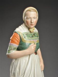 Lot: 1978594 Royal Copenhagen Juliane Marie figurine, no. 12216, model 'Falster' from the series 'Danske Folkedragter'
