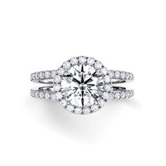 This double shank engagement ring will leave her breathless. Mounting price $4,660: http://www.desiresbymikolay.com/products/danhov-per-lei-diamond-halo-double-shank-engagement-ring