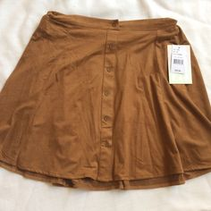 NWT Camel Faux Suede Mini Skirt Available in juniors sizes small, medium and XL. Retail $35.99. New with attached tags. Skirts Mini