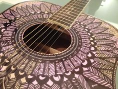Decorating a guitar with a sharpie marker
