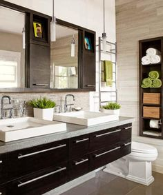 double sink floating vanity. Double sinks on a floating vanity  towel warming rack inset shelving limstone Floating with accent strip of pebble tile underneath Master