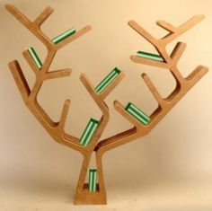 A bookcase for children designed like a tree by Matteo Casarosa.