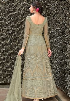Light Green Zari Embellished Designer Anarkali Gown is feminine, appealing and excellent pick for this wedding season . This elegant set has a very pretty zari and zardosi embroidery work detail on. Designer Anarkali, Designer Gowns, Anarkali Suits Online Shopping, Anarkali Tops, Gown Suit, Gown Dress, Net Gowns, Western Gown, Bridesmaid Outfit