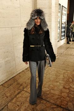Olivia Palermo beats the bad winter weather with a fur lined hat and black jacket at a New York Fashion Week event. (Feb. 8, 2013)