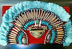 Beaded velvet bag featuring glass beads,  wooden beads and rose petals.  Contact@anitaquansahlondon.com