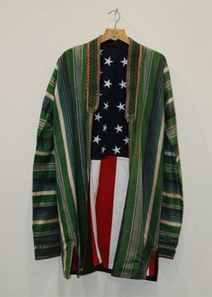Sarah Rahbar: 'A Promise of More - Afghan Coat' 2010; Afghan coat and US flag; 114 x 61 cm