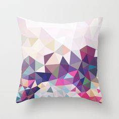 Want to start looking into getting a series of similar geometric cushions - Travelling Tris Throw Pillow by Beth Thompson - $20.00