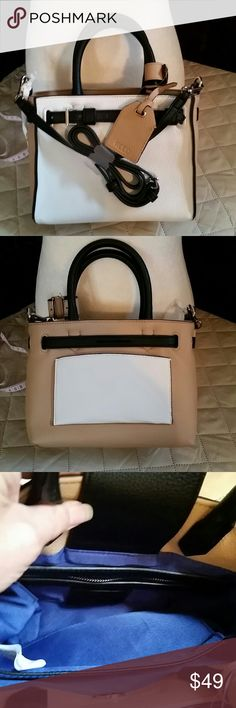 REED purse This is new with tags colorful tan white and black purse perfect for any time of year handle and strap measurements are 9 inches long 4 inches wide 7 inches tall without the straps ,straps are four and a half inches tall REED Bags