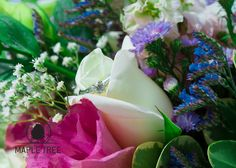 The engagement ring of Rebecca in her wedding bouquet.