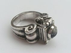stunning!  Pompadour ring - Silver poison (container) ring with snowflake obsidian gem. (etsy blindspotjewellry)