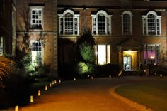 Outdoor flood lighting and candle bags lining the driveway at Dorton House Aylesbury Event Lighting, Outdoor Lighting, Candle Bags, Lighting Solutions, After Dark, Fairy Lights, Outdoor Spaces, Lanterns, Wedding Inspiration