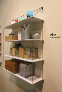 Trim, a suspended shelf system by Gothenburg, Sweden, design studio Akka.