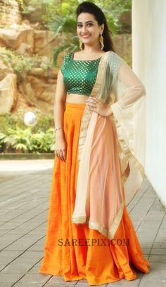 manjusha-in-lehenga-sleeveless-blouse