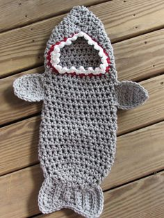 Super cute and snugly shark attack cocoon crochet for your baby out of chunky yarn. This cocoon is perfect for newborn photos and for right out of baths to keep your baby warm for his night time snuggle and snack! This little cocoon measures aprox 23 inches long from top of hood to bottom of cocoon and about 19 inches circumference. Please let me know if you have any questions. Find the pattern here: https://www.etsy.com/listing/467818987/pattern-newborn-shark-cocoon