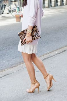 A leopard clutch creates a Glam statement to your outfit!
