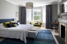 Farrow & Ball Lamp Room Grey walls, grey linen curtains, a blue fabric headboard & vintage rug in the Master Bedroom suite of this Edwardia… – rugcut Bedroom Decor Dark, Gray Bedroom Walls, Home Bedroom, Grey Walls, Blue Bedroom Curtains, Master Bedrooms, Master Suite, Dark Blue Bedrooms, Blue Rooms