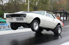 """Bill Emory Pulls Up His 1968 Chevy Camaro With a """"454.stroked out to a 489.all motor.leaf spring car....powerglide, all factory glass and metal except hood...never chopped on"""". #wheeliewednesday #wheelsupwednesday"""