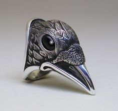 This Raven or Crow ring is cast in solid sterling silver, with inlaid black onyx eyes. This ring is fairly large - I would even say BODACIOUS! Jewelry Rings, Jewelry Box, Silver Jewelry, Jewelry Accessories, Jewelry Design, Silver Rings, Beard Jewelry, Jewellery, Gothic Engagement Ring
