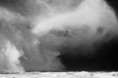 A surfer emerging from the 'mist' at Pipeline (#Hawaii). Photo by Nate Smith