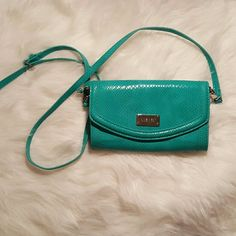NINE WEST crossbody purse! Excellent condition! Teal/turqouise! Shoe print interior. Very clean inside and out. Adjustable and removable strap. Nine West Bags Crossbody Bags