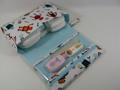 Diaper Clutch with clear zipper pouch-- Robot Factory Organic Fabric. $28.00, via Etsy.