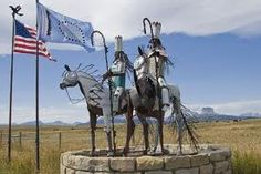 Entrance to Blackfoot Reservation.  Statue partially made of an old car.