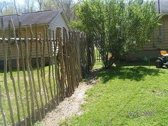 repurposed trees my son cut and made a fence for the backyard, concrete masonry, fences, outdoor living, Fence for the backyard made of repurposed tree cut
