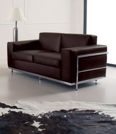 Cook 2 Seater Leather Covered Sofa