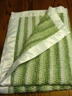 "$25.00 Crocheted Baby Blanket with Satin Binding. 35"" x 28""  Machine Washable."