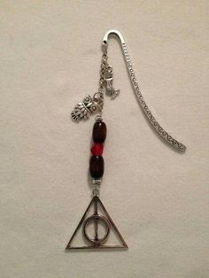Check out this item in my Etsy shop https://www.etsy.com/ca/listing/267966383/hp-deathly-hallows-bookmark