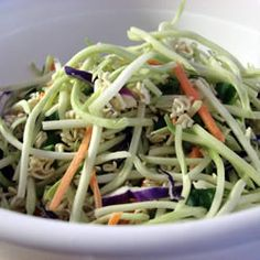Broccoli and Ramen Noodle Salad: 1 ounce) package broccoli coleslaw mix 2 ounce) packages chicken flavored ramen noodles 1 bunch green onions, chopped 1 cup unsalted peanuts 1 cup sunflower seeds cup white sugar cup vegetable oil cup cider vinegar Broccoli Cole Slaw, Broccoli Slaw Salad, Ramen Noodle Salad, Ramen Noodles, Brocolli Slaw, Asian Broccoli, Broccoli Sprouts, Cabbage Salad, Chicken Broccoli