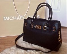 This exclusive Michael Kors giveaway includes: A Statement Handbag, Jet Set Travel Pouch, Buckle and Stud Bangle, Crystal Stud Earrings, and MK Logo Stud Earrings ✨