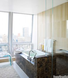 City View  Perched high over Manhattan, this sleek master bath designed by Jim and Phoebe Howard is part of the 2010 Designer Visions project, the entire apartment's design being inspired by the movie Something's Gotta Give.