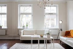 white walled home, living room, white couch, white rug, interior design