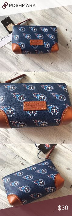 """Dooney Bourke NFL Titans Makeup Cosmetic Bag NWT Brand new with tags and registration card. Dooney and Bourke Tennessee Titans NFL licensed cosmetic case, make up bag. H 5"""" x W 2.5"""" x L 7"""" Zipper closure. Dooney & Bourke Bags Cosmetic Bags & Cases"""