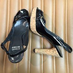 Stuart Weitzman pumps Stuart Weitzman patent cork heel black pumps. 4-5 inch heel, adjustable strap around heel. Worn once Stuart Weitzman Shoes Heels