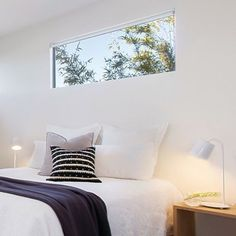 Love the idea of having a horizontal window above bed
