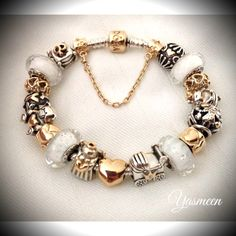 PANDORA Bracelet with White Fizzle Murano, Gold and Two Tone Charms with Heart Theme. By Yasmeen.