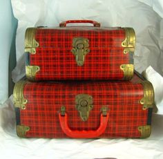 Doll case sized, these metal and brass tone suitcases with plaid lithography are a real treat. Vintage set of tin litho metal storage boxes,
