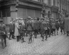 June 1922: Irish Free State soldiers patrolling the streets of Dublin during the Siege of the Four Courts, the headquarters of the anti-Treaty Republicans during the Irish Civil War. (Photo by Walshe/Topical Press Agency/Getty Images)